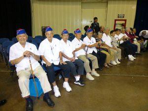 Veterans of the 442nd Regimental Combat Team (wearing garrison caps) and the 100th Infantry Battalion were honored at the Fifth Annual Grassroots Judo National Championships in Honolulu last month.