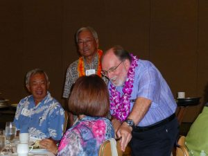 Gov. Neil Abercrombie, accompanied by his longtime friend and supporter and former DOE superintendent Charles Toguchi, greeted attendees at the Hawaii United Okinawa Association's Legacy Awards banquet on July 13.