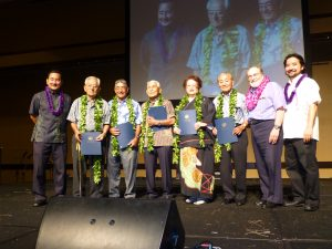 Gov. Neil Abercrombie (second from right), HUOA president Chris Shimabukuro (far left) and president-elect Mark Higa (far right) with the 2014 Legacy Award honorees (from left): Takejiro Higa, Ken Kamiya, Mamoru Kaneshiro, Jane Kaneshiro and retired Judge Herbert Shimabukuro.