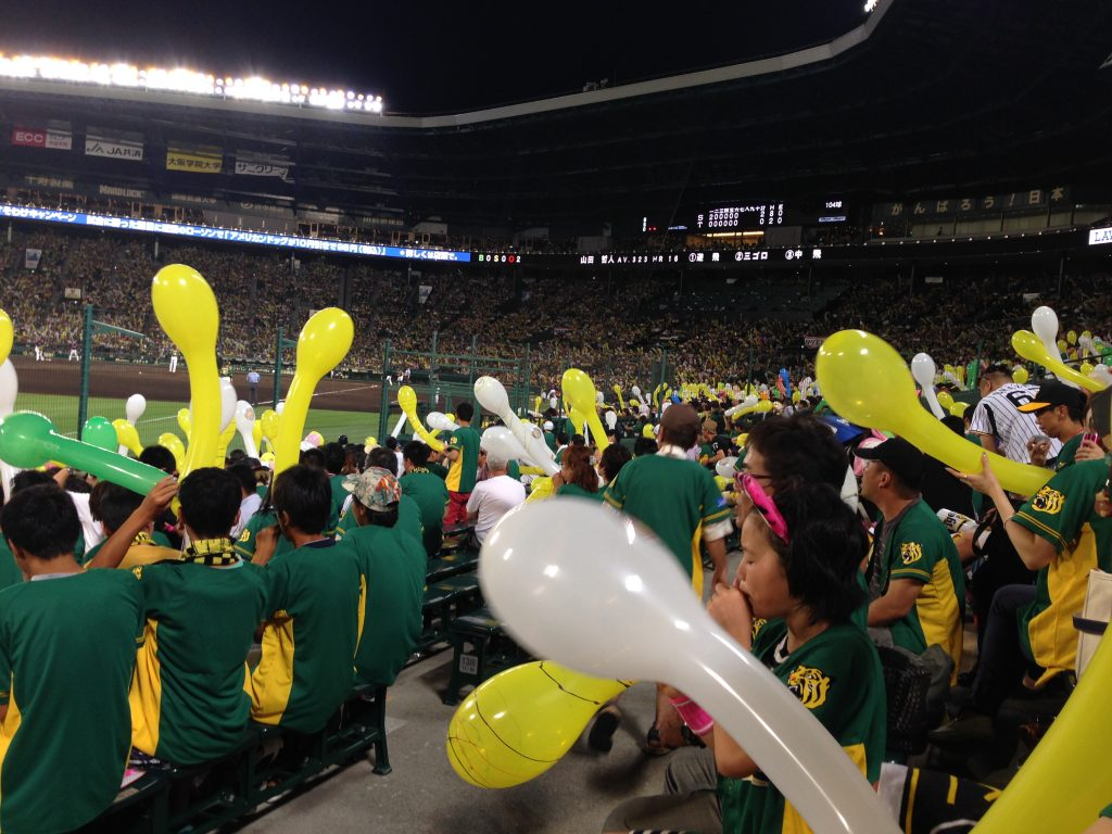 Energetic Hanshin Tigers fans cheer on their team.