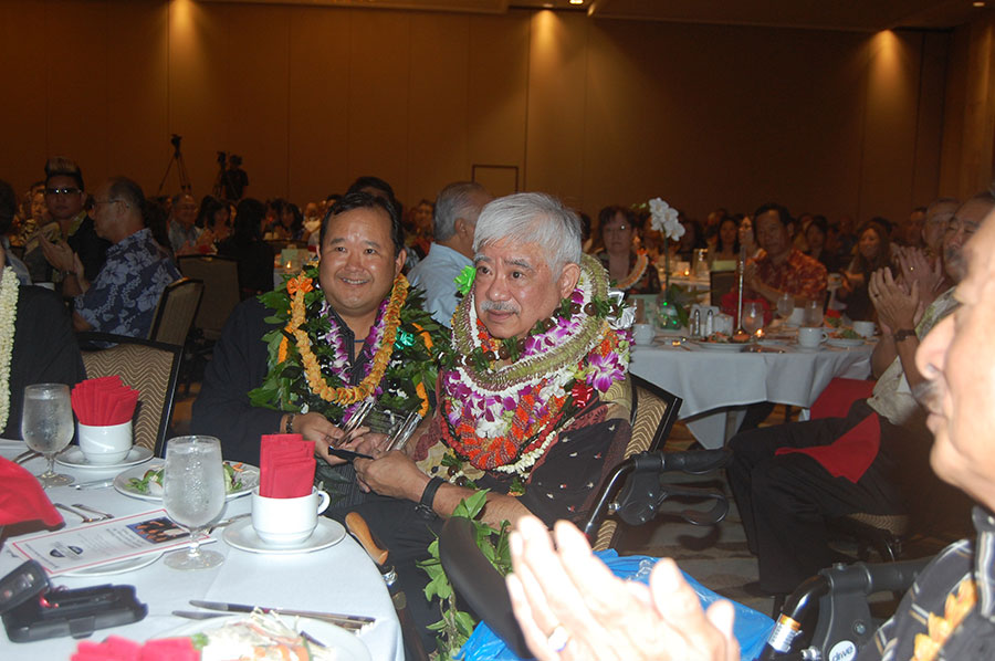 Davis Higa received the 2014 Outstanding Member of the Year awardfrom HJCC immediate past chair Gordon Kagawa.