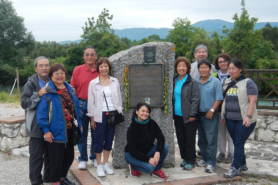 The travelers at the Rapido River Crossing Memorial. From left: Ed and Janice Sakoda, David and Judy Fukuda, our guide Serena, Eleanor and Alvin Shimogaki, Glenna Koyama, and (back row, right) Bryan Yagi and Vanessa Perry.