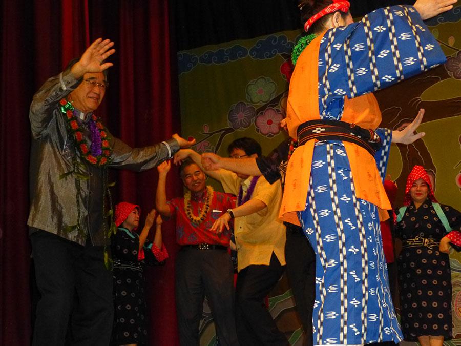 State Sen. David Ige, buried in the crowd, dances kachashi.