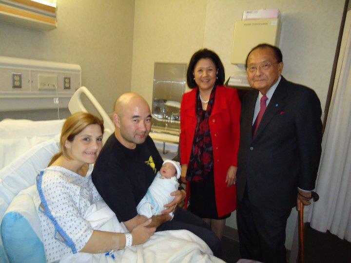 Sen. Inouye and wife Irene Hirano Inouye visit their newborn granddaughter Maggie and her parents, Ken and wife Jessica. (Photo courtesy Ken Inouye)