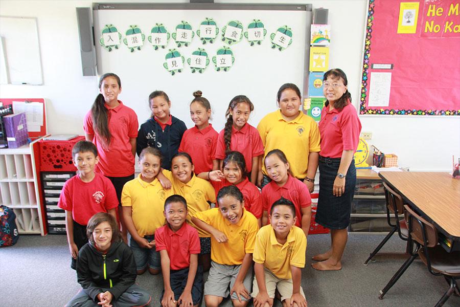 """""""Pilialoha"""" Kimiko Tomita Smith-Sensei with her Näwahï students."""