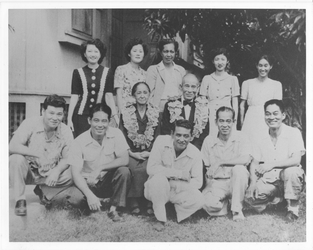 The Harman keiki have been taught their Japanese mo'okü'auhau (genealogy) in Hawai'i. Their great-great-grandparents, Noburo (kneeling, third from left) and Mariah (Lono) Suganuma (standing, third from left), are pictured in this photo with Noburo's parents, Seiji and Nao Suganuma (wearing lei). (Photo courtesy Harman family)