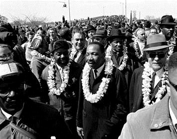 A 1965 Associated Press photo of Dr. Martin Luther King Jr. wearing lei that had been presented to march leaders in Selma for the second march by the Rev. Abraham Akaka from Hawai'i.