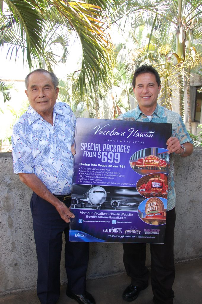 First-prize winner Toshi Shimizu (left) with Kevin Kaneshiro, sales and promotions manager for Vacations Hawaii.