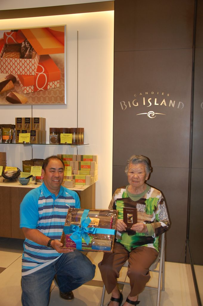 Malcolm Murasaki, Big Island Candies director of sales – business development with second-prize winner Yumie Tamura.