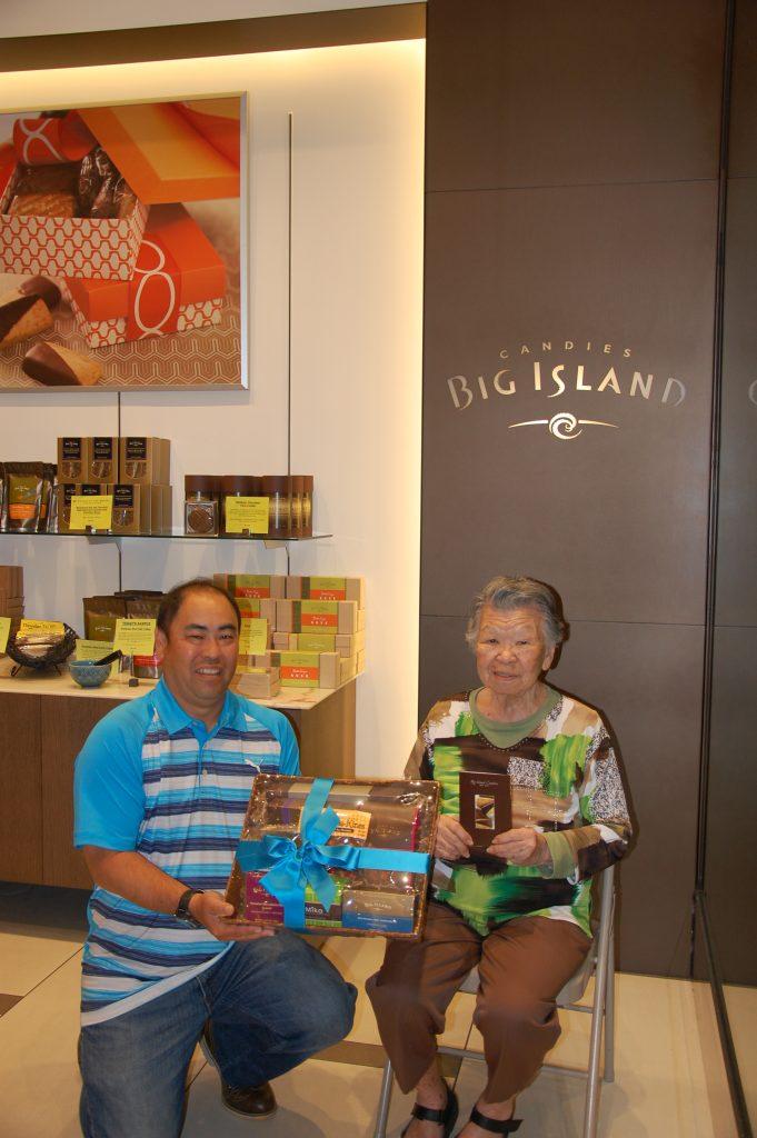 Malcolm Murasaki, Big Island Candies director of sales – business development with second-prize winner Yumie Tamura.