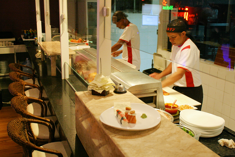 A view of Takê's open-air kitchen where sushi is prepared.