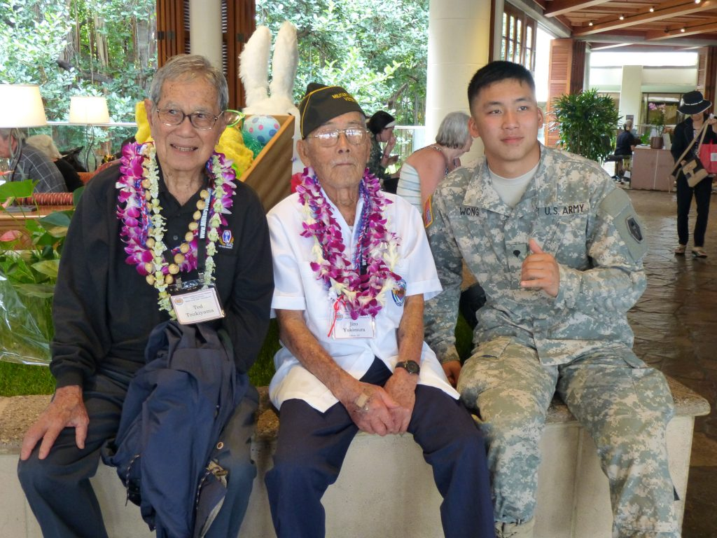 From generation to generation: MIS veterans Ted Tsukiyama and Jiro Yukimura with Spec. Matthew Wong of the 100th Batallion, 442nd Infantry U.S. Army Reserve unit.