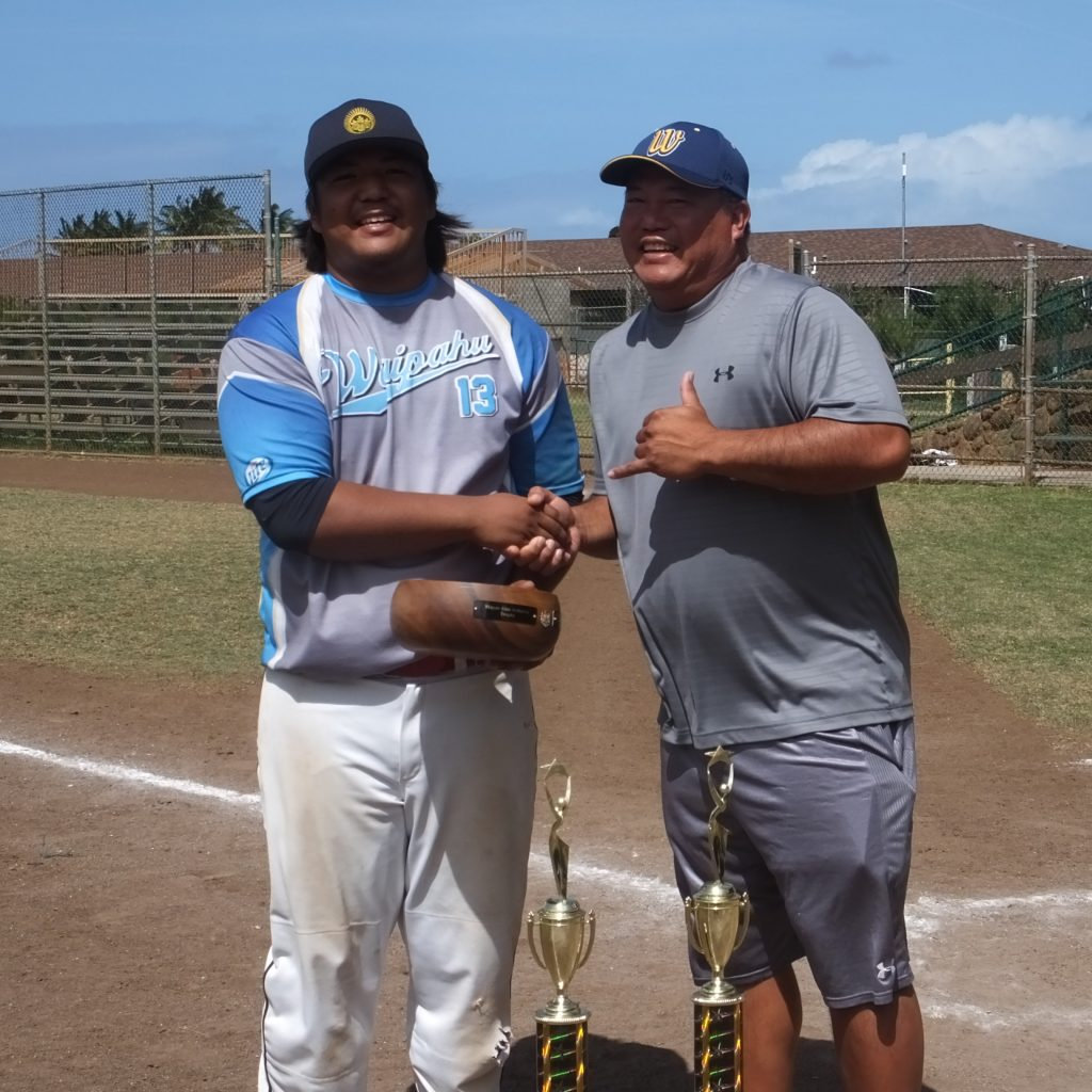 Chevas Numata was named the tournament's Most Outstanding Player, as well as Batting Champion and Most RBI award winner. He is pictured here with his father, Nathan Numata, who was selected the state tournament's Most Outstanding Player in 2000.