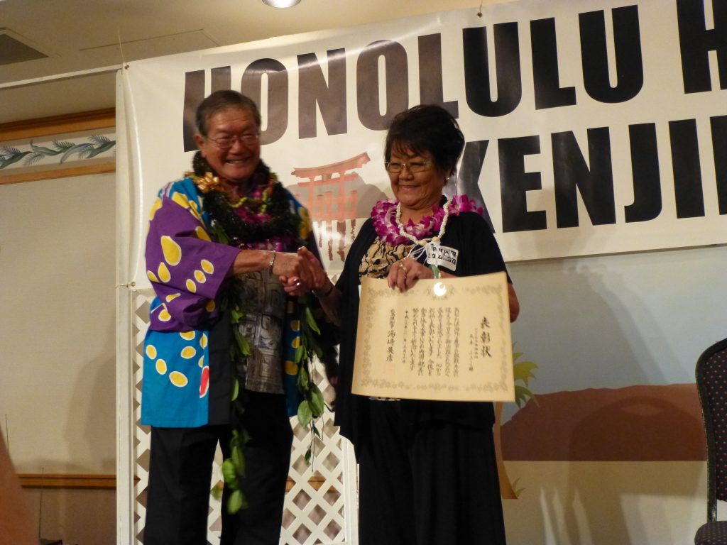 "The Hiroshima Goodwill Ambassadors — (from left) Riyo Sekimoto, Mayu Matsuoka and Nagisa Yoshida — entertained the kenjin members by singing ""Hiroshima Kibun,"" a cheery tune about the special feeling one gets in Hiroshima."