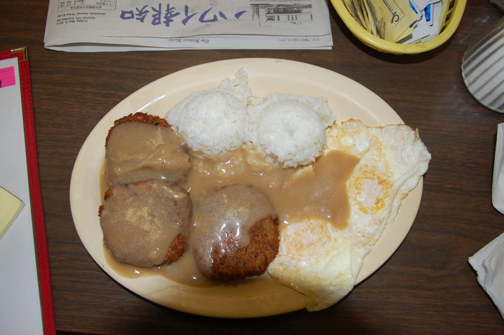 The corned beef loco moco included corned beef/hamburger croquette-style patties, rice and an egg, topped with brown gravy.