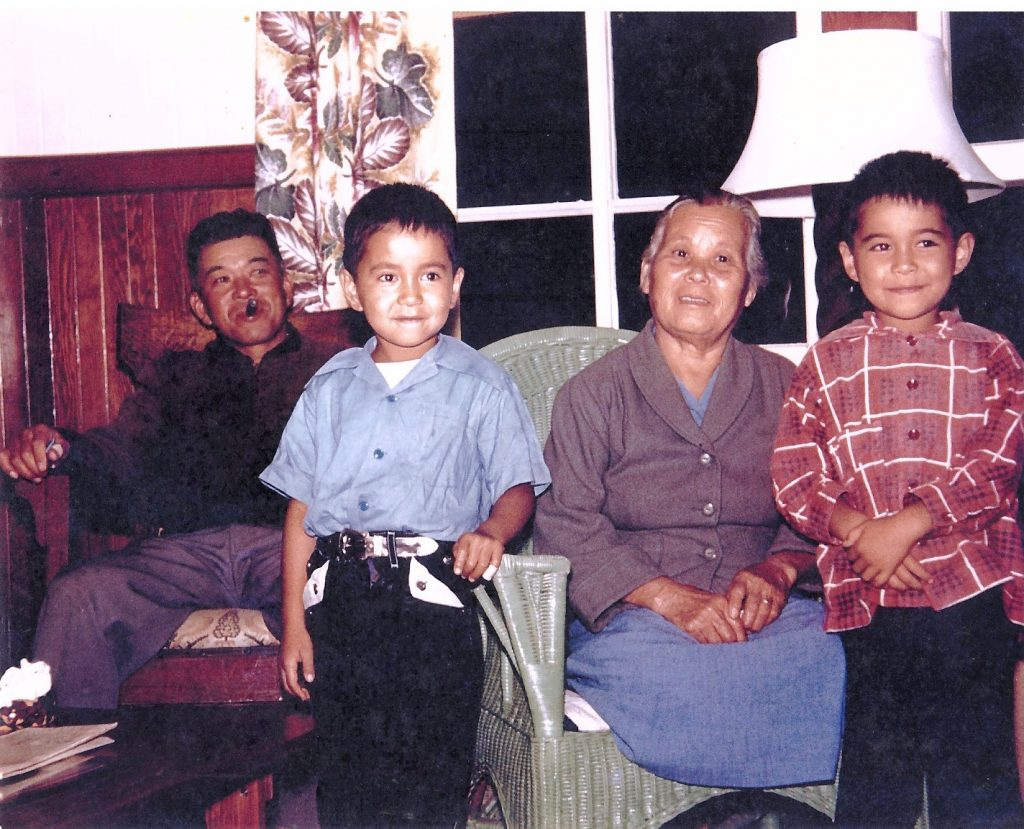 Uncle Yutaka Kimura, a Parker Ranch cowboy (far left) and Baban with Lester and Larry.