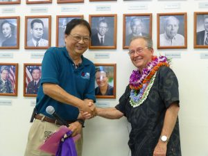Lloyd Kitaoka congratulates Graham Salisbury on behalf of the 100th Infantry Battalion Veterans Club.