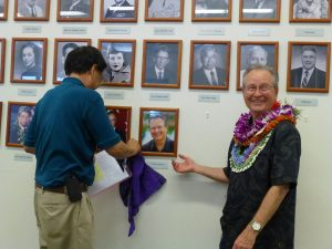 "Graham ""Sandy"" Salisbury smiles boyishly as 100th Infantry Battalion Veterans Club president Lloyd Kitaoka uncovers the author's portrait on the Honorary Members wall at the clubhouse."