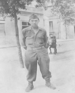 TEC 4 Tsutomu Ogata on an unidentified European street during his service with the 100th Infantry Battalion. (Photo courtesy Ogata family)