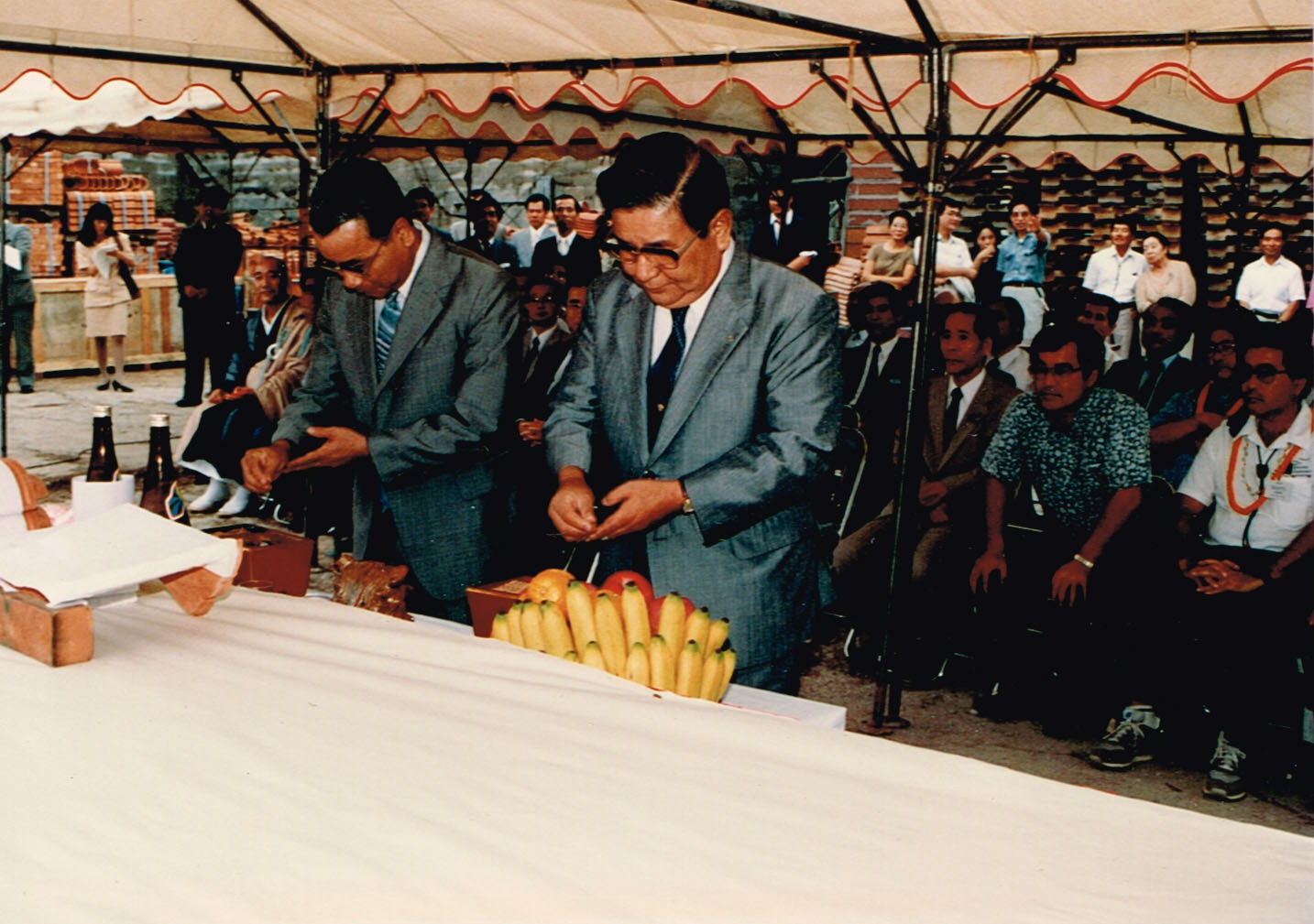 The kawara tile used for the roof of the Hawaii Okinawa Center is blessed by officials in Okinawa before being shipped to Hawai'i. HOC co-chair Gary Mijo and 1988-89 president John Tasato (seated, front row, far right) participated in the blessing ceremony in Okinawa. (Photo by Karleen Chinen)