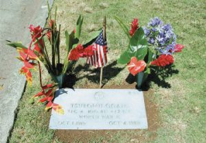 TEC 4 Tsutomu Ogata is remembered with flowers and an American flag on Memorial Day. (Photos by Chance Gusukuma)