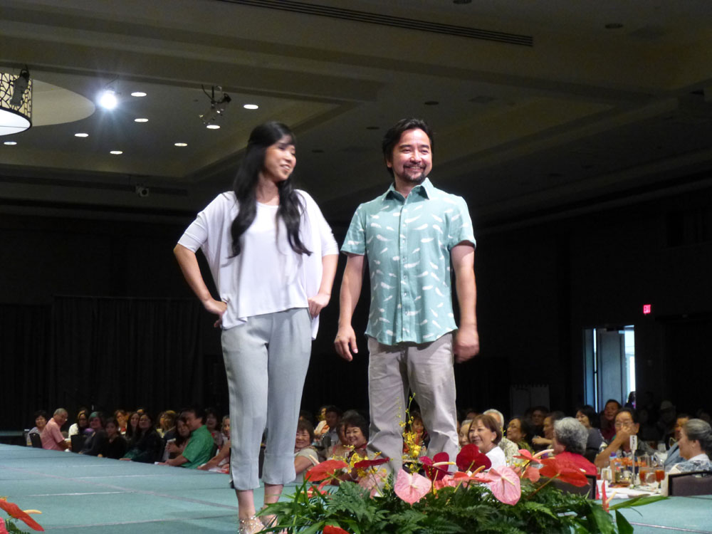 HUOA president Mark Higa and his wife Hanae model outfits designed by Allison Izu.