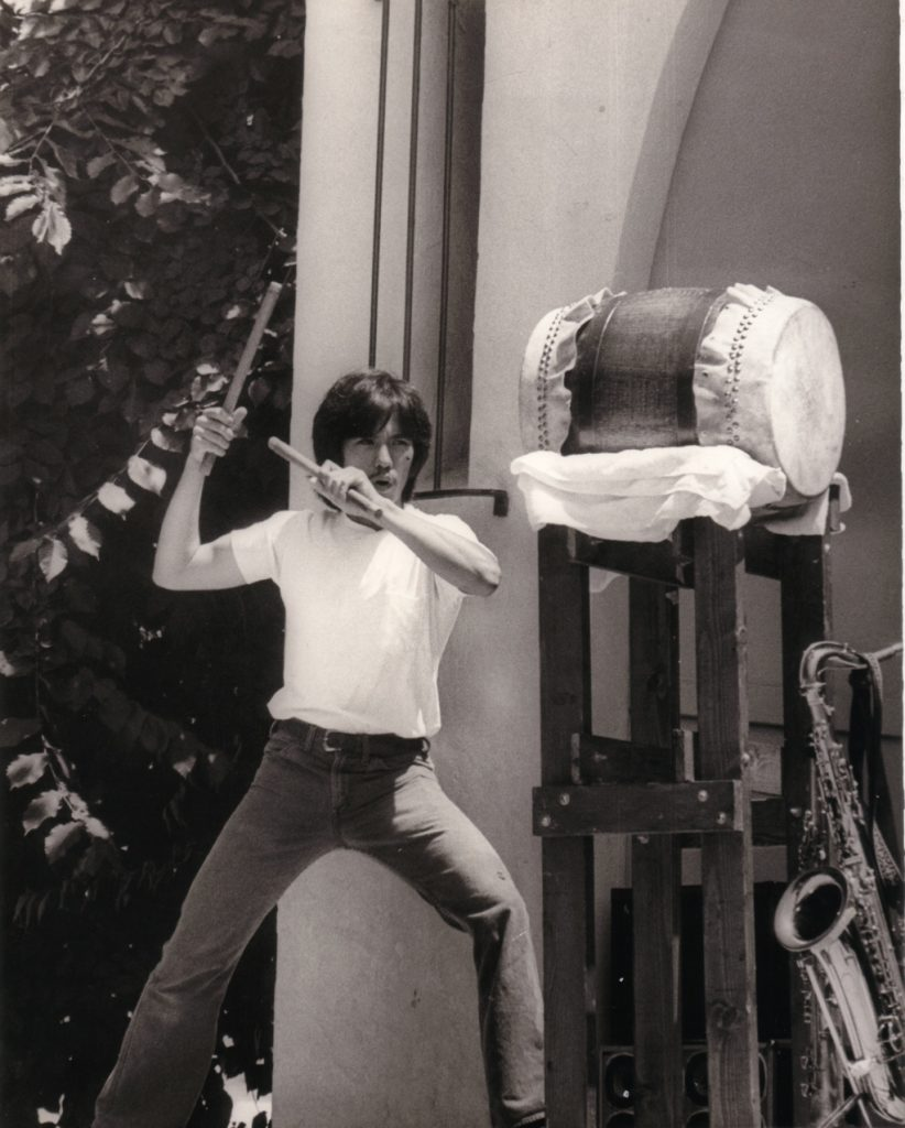 In 1976, Kenny Endo plays the first taiko drum he ever made. He was donated the drum to the Japanese American National Museum in Los Angeles. (Photo courtesy Taiko Center of the Pacific)