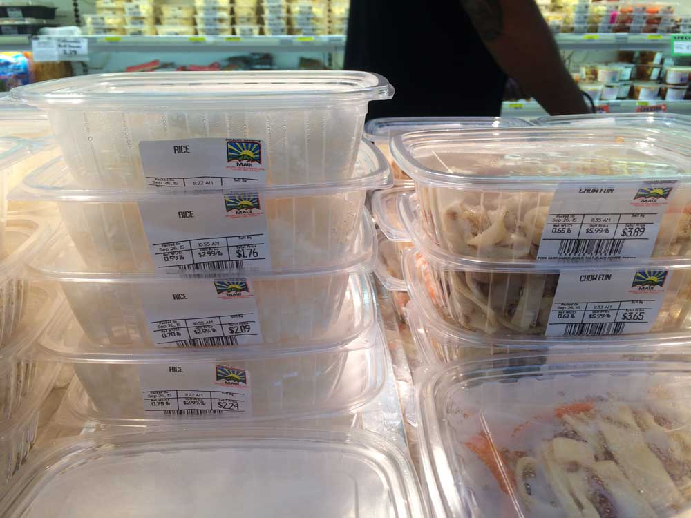 Plastic containers of hot rice are a hot seller at Pukalani Superette.