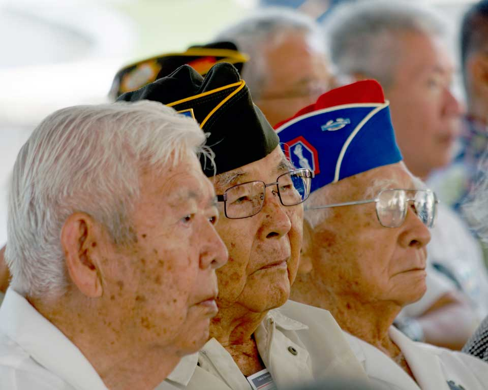Military Intelligence Service veterans (from left) Robert Honke, Kenzo Kanemoto and Iwao Yokooji listen to Rabbi Aronowitz's talk. (Courtesy NVLC Photo Committee)