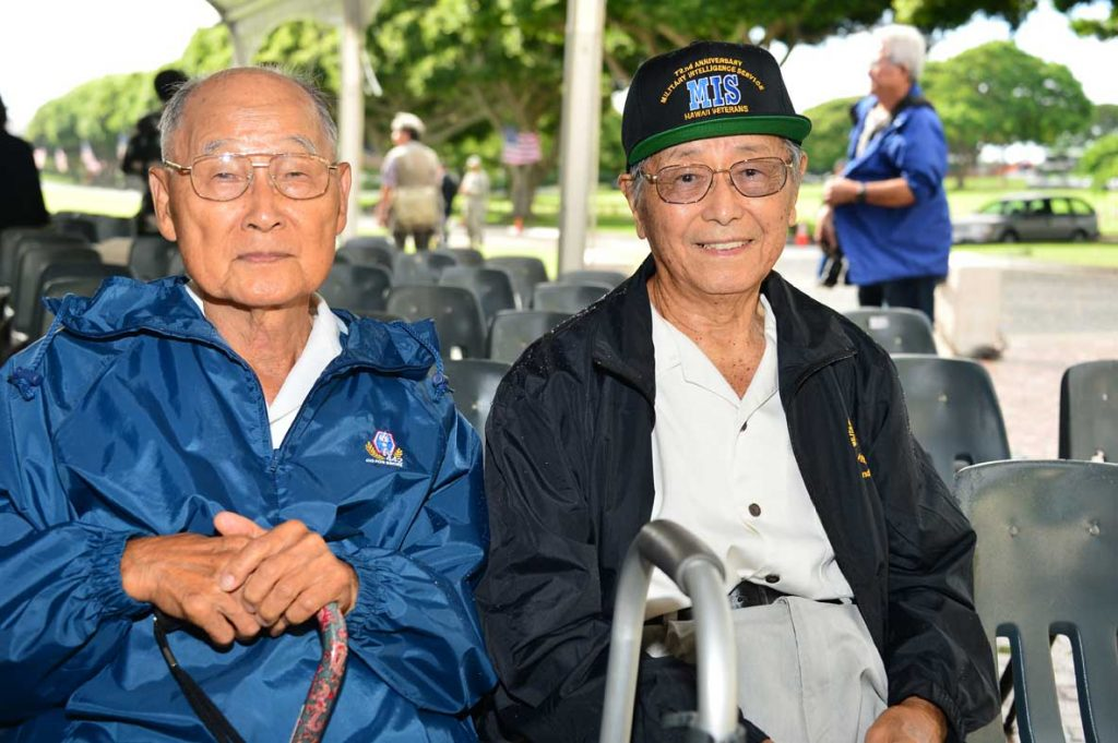 "442nd RCT Anti-tank Company veteran Shiroku ""Whitey"" Yamamoto with his Laupähoehoe High School classmate Dr. Mitsuo Adachi, an MIS veteran. (Courtesy NVLC Photo Committee)"