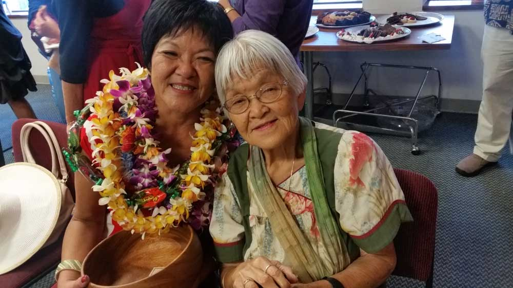 "Kathy and her mom, 90-year-old Yaemi Yogi, share a happy moment together. Collins describes her mother as being ""a bit of a ham herself."""