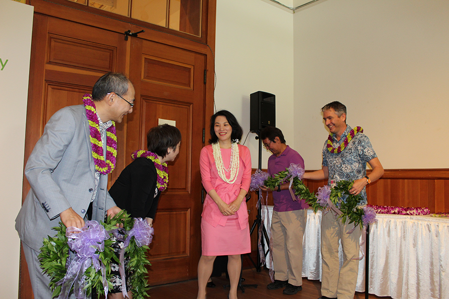 "The Ikenobo Ikebana Society of Honolulu celebrated its 35th anniversary by presenting an exhibition of beautiful and creative floral arrangements by society members, such as that of Michiko Oba of 'Aiea (pictured at left). Michiko Oba's parents, the Rev. Hakuai and Kako Oda, are credited with bringing the art of ikebana to Hawai'i from their native Japan. Kako Oda went on to serve as the first president of the Honolulu Chapter. ""Ikebana . . . Bringing peace and Harmony"" was the theme of the exhibition, which was held Oct. 15 through 18 at the Honolulu Museum of Art School. The society also welcomed Yuki Ikenobo (above, center), 46th headmaster designate, from Kyöto, and a delegation of other Ikenobo ikebana guests from Japan. She joined Consul General of Japan Yasushi Misawa, Honolulu Museum of Art director Stephan Jost and society president May Hiraoka-Tomita for the untying of the maile lei, officially opening the exhibit. Yuki Ikenobo-Sensei also conducted demonstrations during her visit to Hawai'i for the anniversary."
