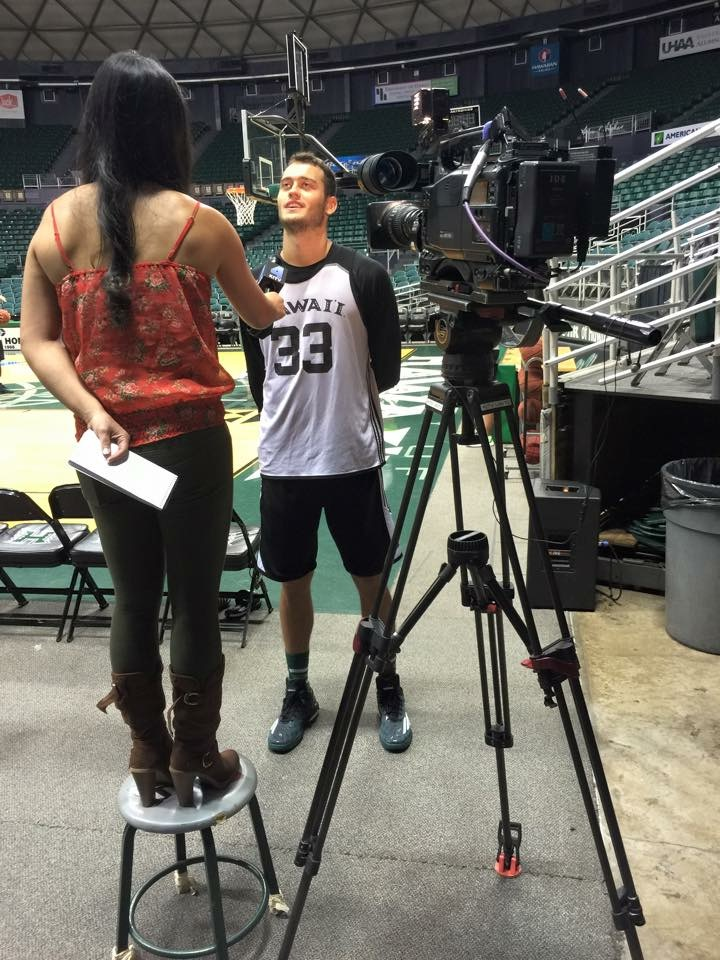 At 5-foot-5, Brandi Higa knew that UH Basketball Bows' 6-foot-9 forward Stefan Jankovic would tower over her during their interview, so she came prepared to level the playing field. (Photo courtesy Brandi Higa)