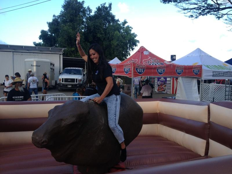 Earlier this year, Higa reported from atop the bull ride at Dita Holifield's All American Rodeo in Waimänalo. (Photo courtesy Brandi Higa)
