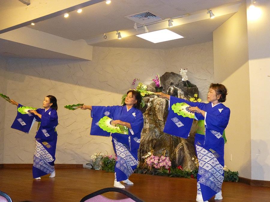 "Onoe Kikunobu Dance Company students (from left) Onoe Kikunobuemi (Carrolyn Emoto), Onoe Kikunobuyuki (Jo-ann Toma) and Onoe Kikunobunori (Corinne Gyotoku) dance to Misora Hibari's hit song, ""Kawa no Nagare no Yö ni,"" as a tribute to their teacher."