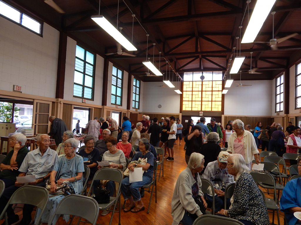 The overflow crowd mingles in the Wahiawa Hongwanji Mission social hall before the event.