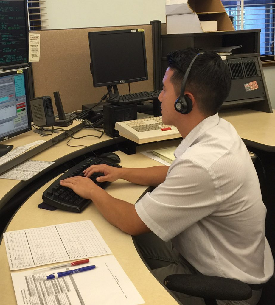 An HPD 9-1-1 dispatcher at work.