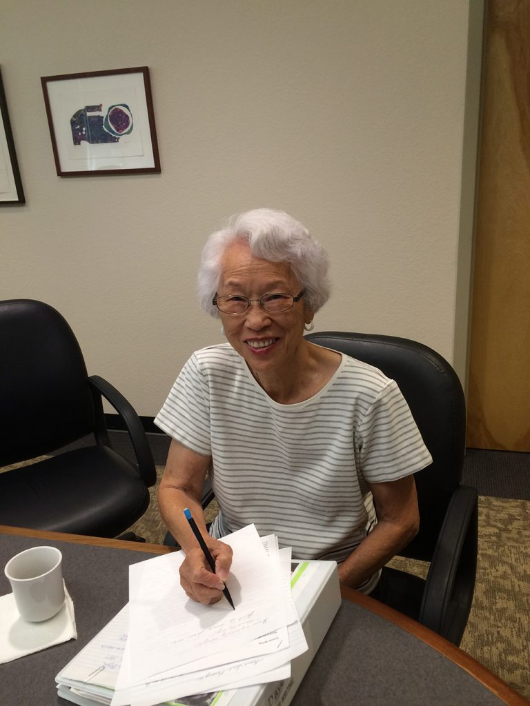 Mabs writes out her memoirs at a group session of Memoir Miners, organized by Frances Kakugawa. Capturing her thoughts helps her cope with her Alzheimer's disease. (Photo by Frances Kakugawa)