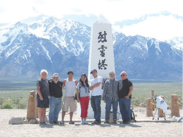 Sansei artists and activists at the Manzanar Monument in Owens Valley, Calif., in the early 2000s. Behind them is the Sierra Nevada mountains. From left: Bill Sorro, Pete Yamamoto,Tadashi Nakamura, Shirley Ancheta, Eric Tandoc, Al Robles and Bob Nakamura. (Photo by Karen L. Ishizuka)