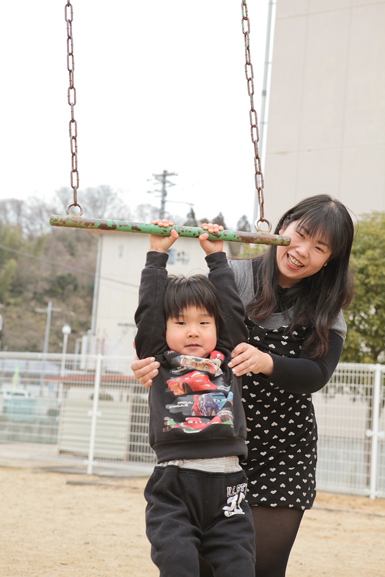 "Yusei Uemura enjoys the playground equipment near his home with help from his mother Yukiko. ""Yusei is no different from any other boy, except he has been interviewed by the media every March 11,"" says Yukiko."