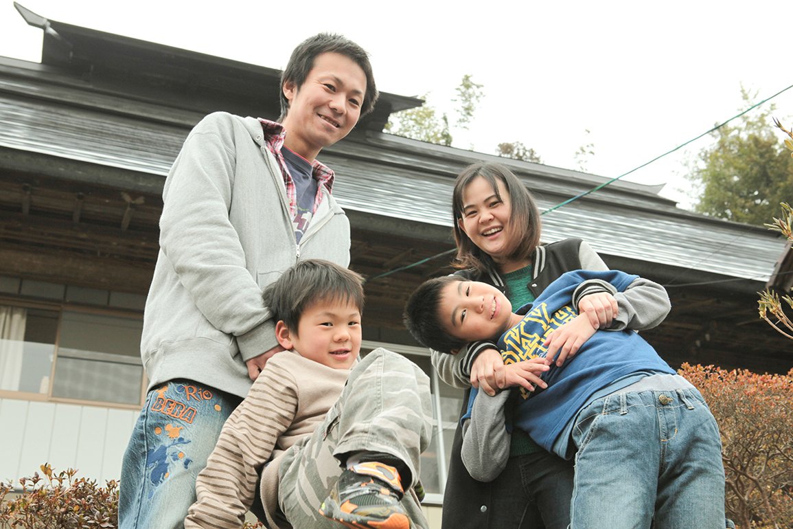 "The Watanabe family at their home in Miharu-machi — father Toshimasa, mother Aki, brothers Kuruto, 5, and Haoto, 10. Aki encourages people who visit Fukushima to ""Buy Fukushima"" to help support the prefecture's economy."