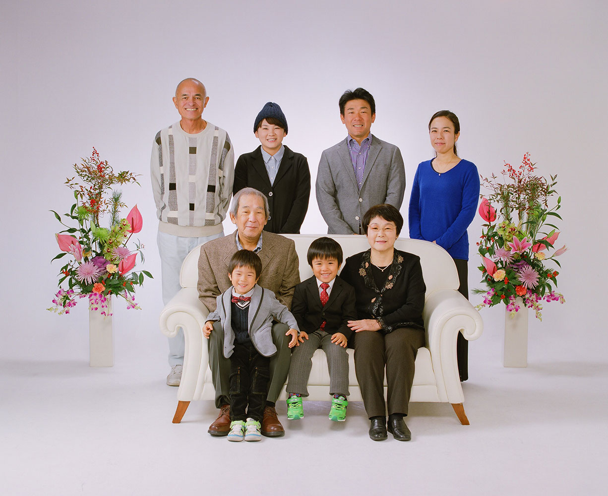 My Okinawa family — the Noharas. Seated: Ayao-san with Sota, and Hisae-chan with Yuta. Standing: myself, Sugako, her brother Daisuke and sister-in-law Riemi.