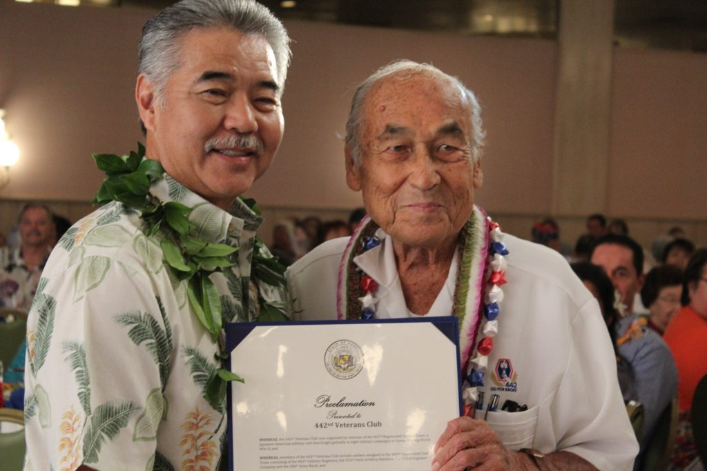 Gov. David Ige presents a prtoclamation to 442nd Veterans Club president William Thompson.
