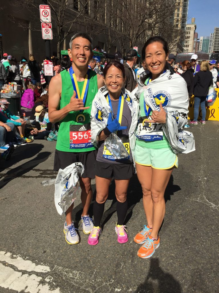 Finishers! Meredith Kuba (far right) with her brother-and-sister running buddies Duane and Cheryl Tamashiro, all wrapped in their foil blankets, after completing the race. (Photos courtesy of Meredith Kuba)
