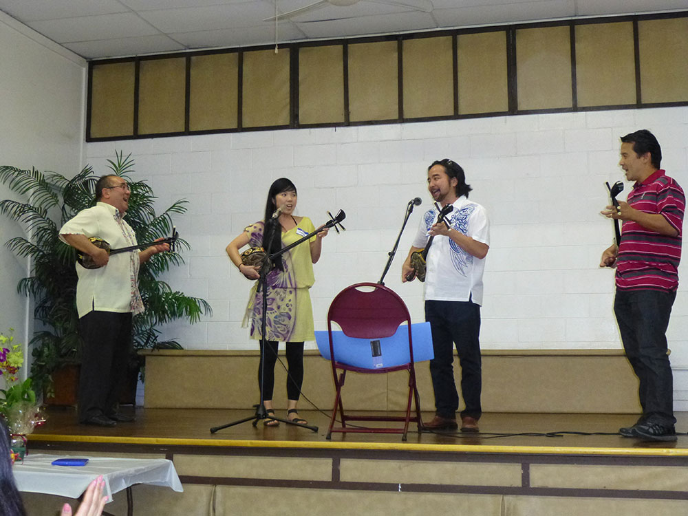 "Afuso Ryu sanshin sensei Grant ""Sandaa"" Murata (far left) and Kenton Odo (far right) and sanshin students Hanae and Mark Higa performed several songs for Deigo Club members."