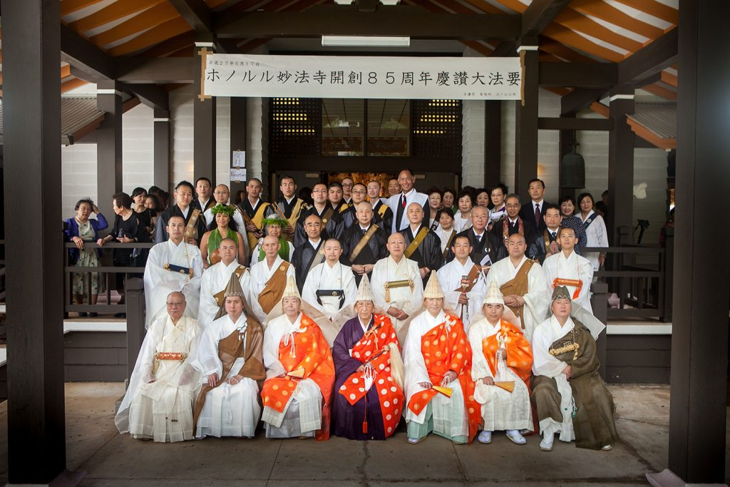 Nichiren Buddhist ministers from Hawai'i and Japan gather for a group photo with Honolulu Myohoji Mission members and other Hawai'i Buddhist leaders at the temple 85th anniversary commemoration. Rev. Takamasa Yamamura is seated in the first row, second from left. (Photo courtesy of Rev. Takamasa Yamamura)