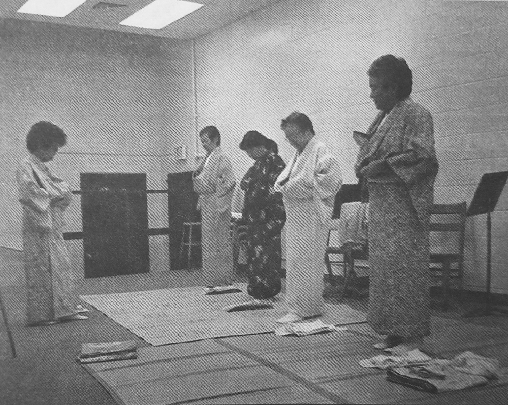 "Jean Sakihara (left) leads students in the ""Hakubi-mai."" (Hawai'i Herald file photo)"
