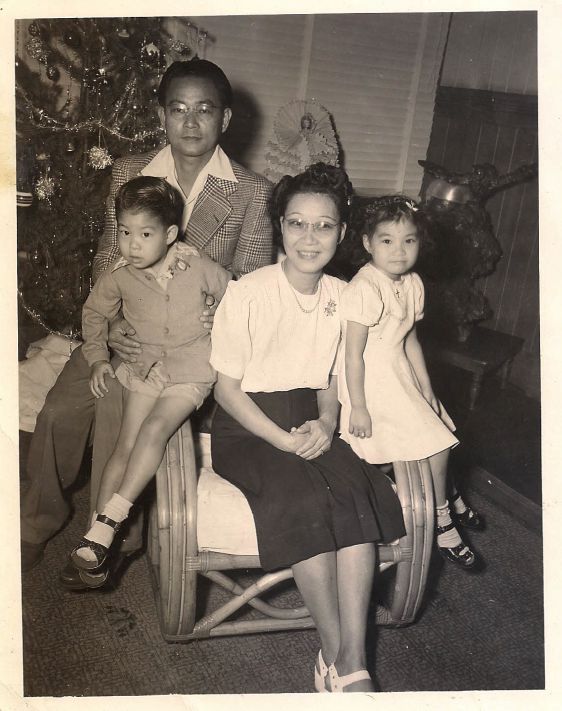 Edward and Itsuko Takamura with their children, Carl and Ruby, at Christmas 1948. (Photo courtesy of Carl Takamura)