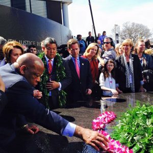 Congressman Mark Takai watches intently as his House colleague and eyewitness to history Congressman John Lewis places a lei sent from Hawai'i at the Civil Rights Memorial in Montgomery, Ala.