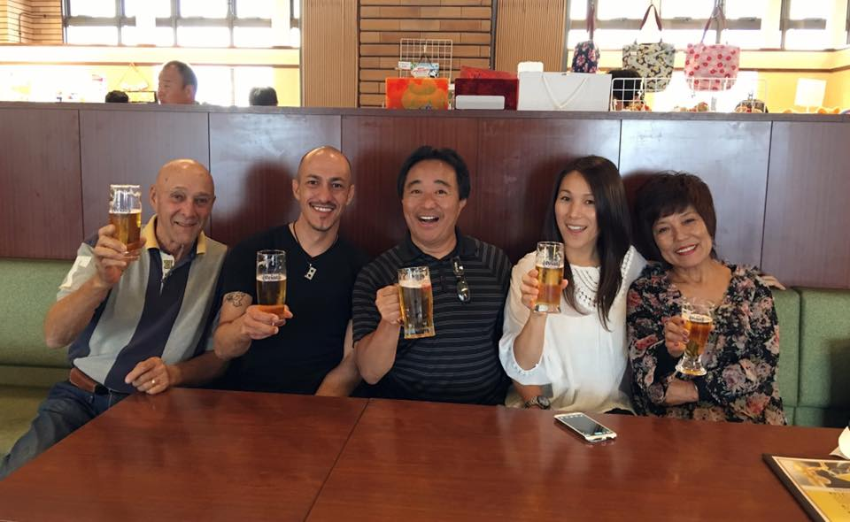 Enjoying a beer in Okinawa last November. From left: David and Michael (Glenn's half-brother) Boughton, Glenn and Miki Wakai and Yoko Boughton.